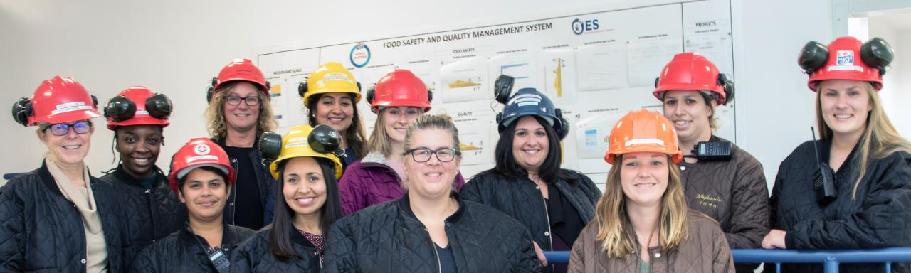 Women standing in front of food safety whiteboard