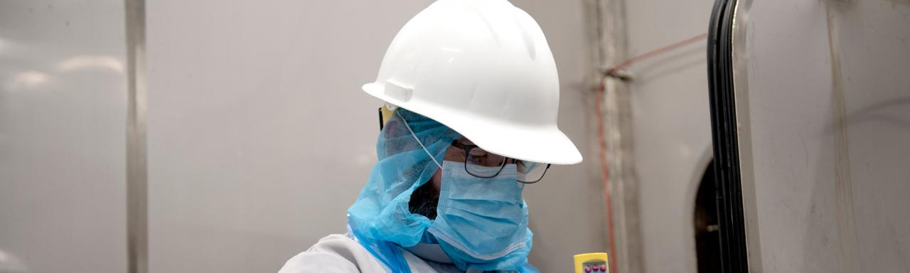 Employee in full PPE working at Heritage Plant.